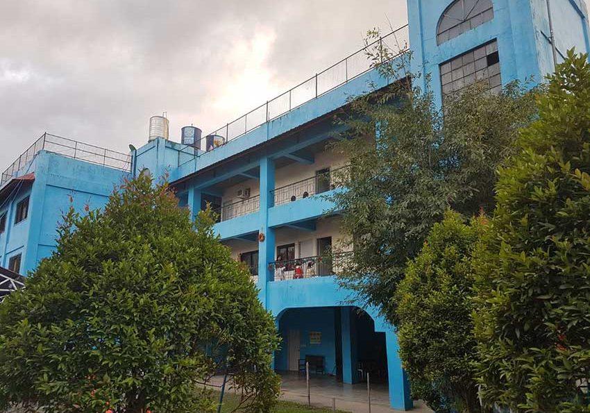 mango-house-blue-building